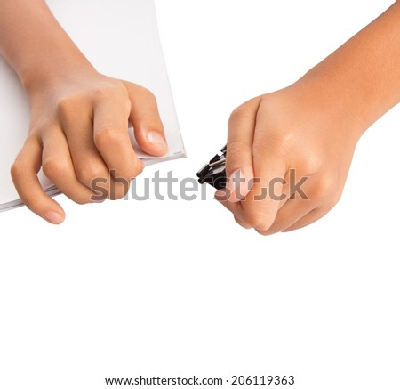 Female hand holding white paper with binder clips over white background