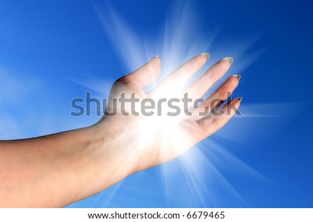 female hand with mystical light coming out of her hand