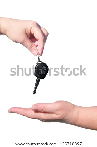Female handing over the keys of car to another person