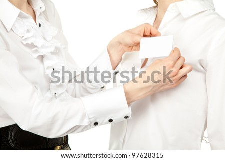 Female hands fastening badge; studio shot illustrating conference/business meeting