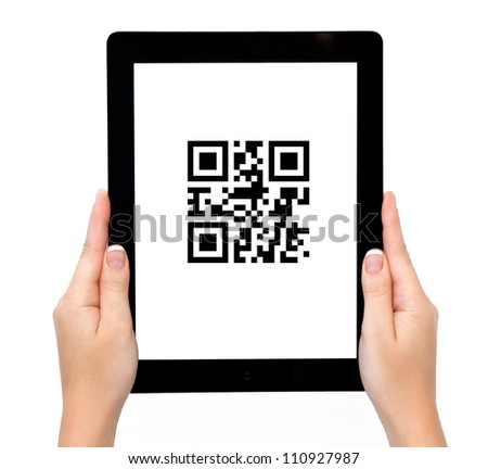 female hands holding a tablet touch computer gadget with qr code