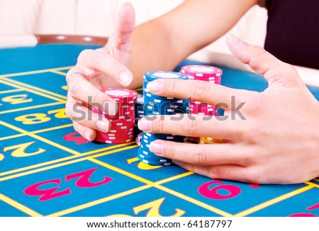 female hands holding chips