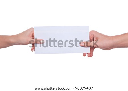 female hands passing exchange letter in envelope. isolated on white