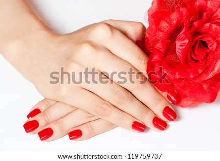 Female hands with red manicure