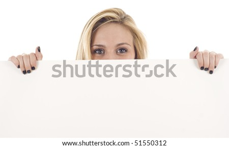 Female holding sign or board - Portrait of a beautiful woman holding a blank billboard