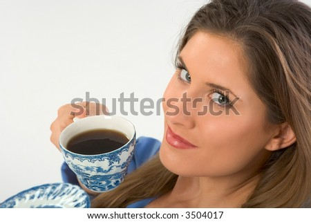 female looks up drinking her morning coffee