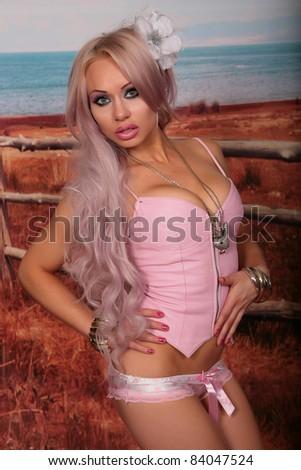 Petite Slender Blonde Pink Crepe Dress Stock Photo
