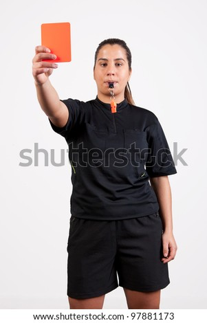 female referee showing the red card