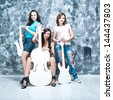 female rock band. girls with musical instruments: guitar, saxophone and cello - stock photo