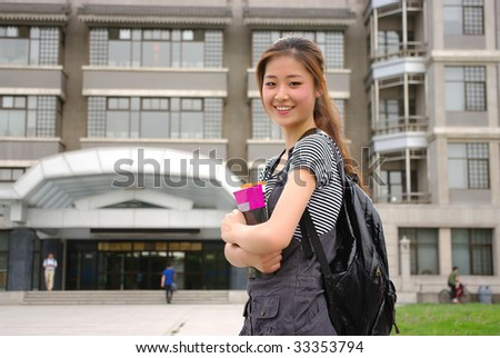 female student in front of a library of university