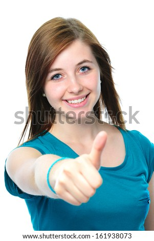 female teenager shows a thumbs up on white background