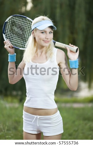 Female tennis player with a racket outdoors