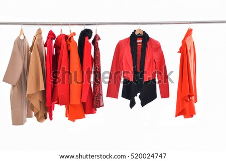 Female Variety of clothes hanging on hangers