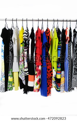 Female Variety of colorful clothes hanging on the rack