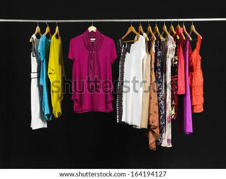 Female Variety of sundress clothes hanging on the rack-black background