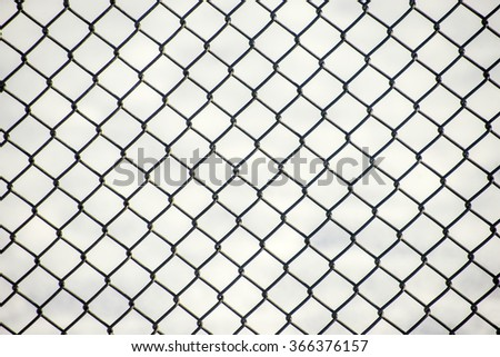 rusty chain link fence texture. fence with snow in the background rusty chain link texture t