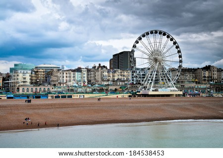 Ferris wheel and cityscape of Brighton in England