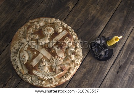 Festive baked bread on wooden background. From above