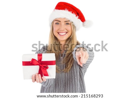 Festive blonde holding christmas gift on white background