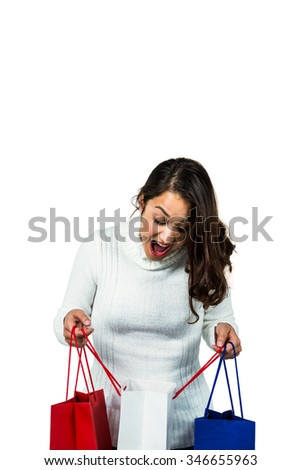 Festive brunette smiling with gifts on white background