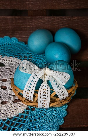 Festive painted eggs lie on a wooden rustic background.