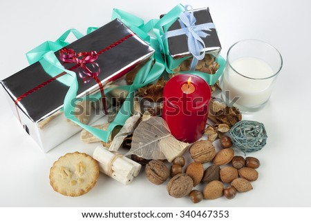 Festive seasonal christmas display with mince pie and a selection of nuts on a white background