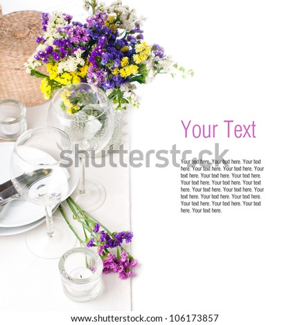 Festive table setting and decoration with fresh flowers