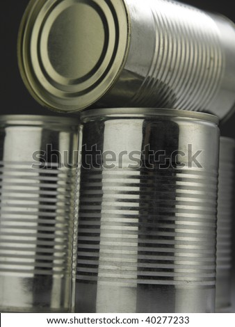 few aluminum cans with reflection