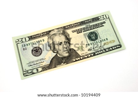 fifty dollar bill over a white surface
