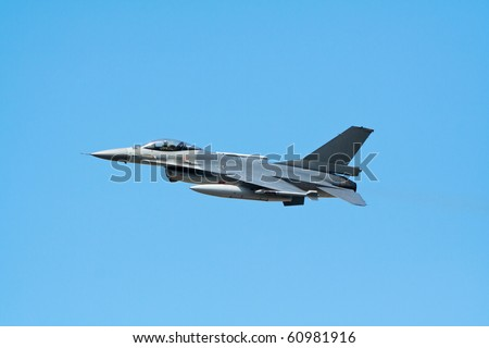 fighter jet flying with a blue sky background