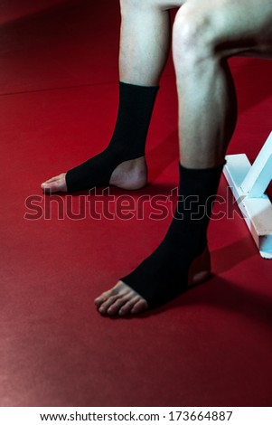 Fighter Putting Straps On His Foot