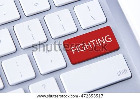 Fighting word in red keyboard buttons