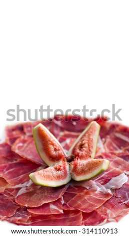 Figs with sliced jamon, parma. Traditional tapas, dish from Spain. white background. isolated.