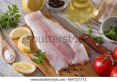 Fillet fish on kitchen board stock photo 487091590 for Fish fillet board