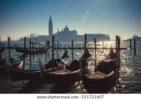 Filtered hipster style image of Gondolas on Grand canal in Venice, Italy. Beautiful summer landscape at sunrise.