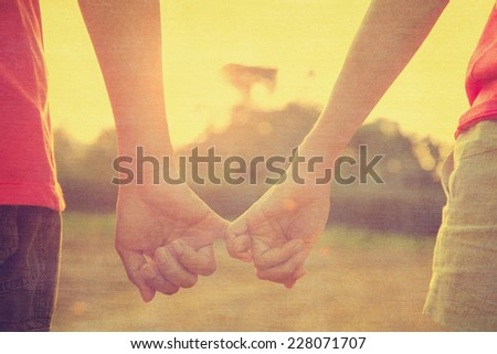 Filtered image, couple holding hands in wedding outdoor theme