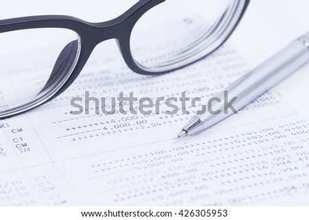 Finance Concepts, pen and glasses with passbook as background