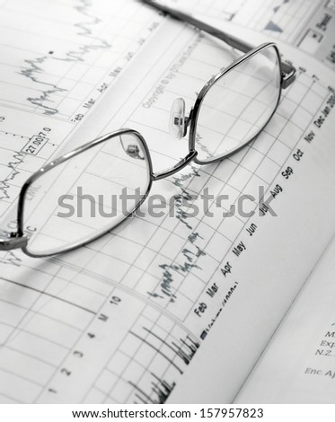 Financial charts and glasses