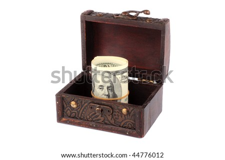 Financial security concept - Dollars in a wooden chest isolated on the white background