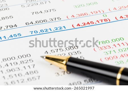 Financial Statement report focus on pen; document is mock-up