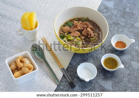 fine cut white rice noodle thicken soup with sliced pork and pork ball
