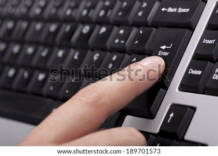 finger on the enter key