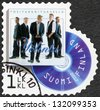 FINLAND - CIRCA 2012: A stamp printed in Finland shows band Yolintu, series on Finnish music has reached the 1990's, circa 2012 - stock photo