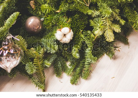 fir branches with ornaments in florist shop