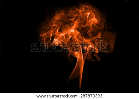 Fire and smoke isolated with light on black background