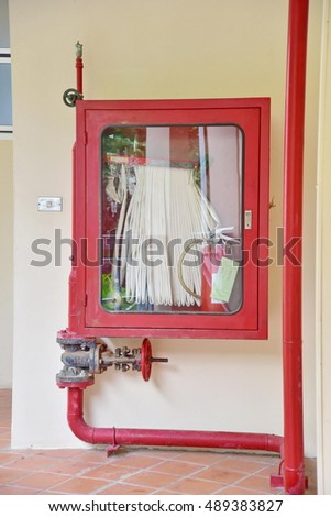Fire cabinet and pipe in building
