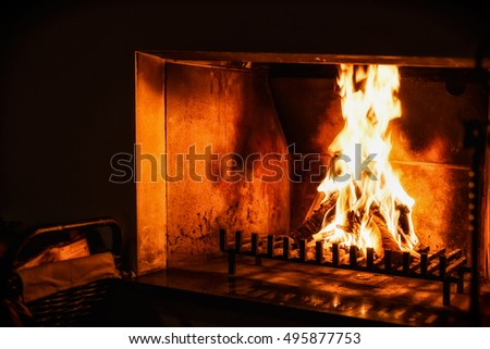Fire in the old fireplace in dark room