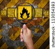Fire symbol in Magnifying glass , industry background - stock photo