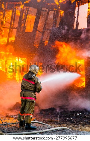Fireman extinguishes a fire
