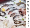 Fish and seafood on iced market display - stock photo
